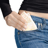 Woman's hand holding a bundle of banknotes isolate Royalty Free Stock Photo