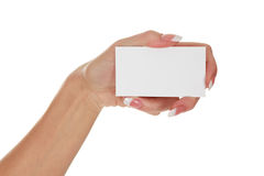 Woman`s hand holding a business card. Isolated on white background Royalty Free Stock Photo