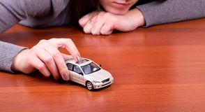 Woman\'s hand holding car Stock Image