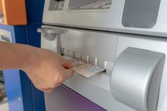 Woman`s hand holding cash withdrawn from ATM royalty free stock photo