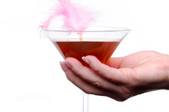 Woman's hand holding a cherry cocktail Royalty Free Stock Images