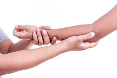 Woman's hand holding children's elbow. Elbow pain concept Stock Photos