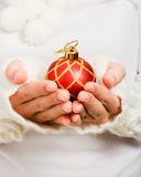 Woman's hand holding a Christmas ball Royalty Free Stock Photography