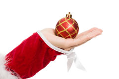 Woman's hand holding a Christmas ball Royalty Free Stock Image