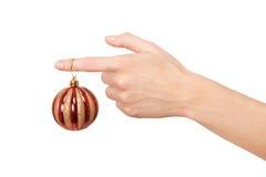 Woman's hand holding a Christmas ball Stock Image