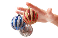 Woman's hand holding a Christmas balls Royalty Free Stock Photos