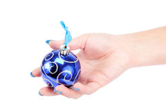 Woman's hand holding a Christmas toy-ball. Stock Photo