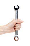 Woman's hand holding a chrome wrench. Royalty Free Stock Images