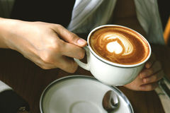 Woman`s hand holding coffee cup, Coffee cafe aroma beverage. Royalty Free Stock Photo