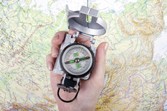 Woman's hand holding a compass Stock Photo
