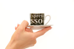 Woman's hand holding espresso coffee cup. Over the white background Royalty Free Stock Images
