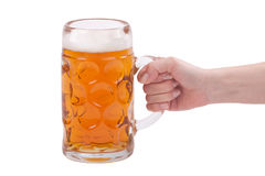 Woman's hand holding a glass of beer Stock Photos