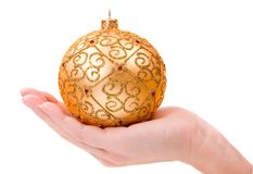 Woman's hand holding gold ornament Stock Photography
