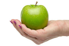 Woman's hand holding a green apple Royalty Free Stock Photo