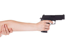 Woman's hand holding a gun Royalty Free Stock Images