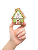 Woman's hand holding a house Royalty Free Stock Images