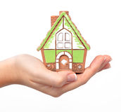 Woman's hand holding a house Stock Photography