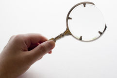 Woman's hand holding magnifying glass Royalty Free Stock Images