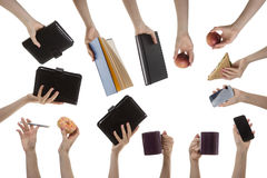 Woman's hand holding many different objects Stock Photo