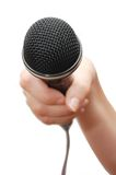 Woman's hand holding a microphone Royalty Free Stock Photo