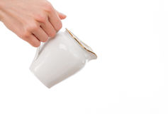 Woman's hand holding milk jug Stock Images