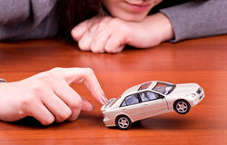 Woman's hand holding the model of car Stock Photos