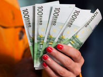 Woman`s hand holding money. Woman`s hand holding Euro money 100 Euro banknotes Stock Photos