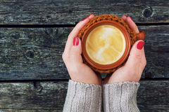 Woman's hand holding a mug of coffee Stock Photos
