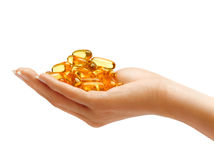 Woman's Hand holding Omega 3 capsules Royalty Free Stock Photo