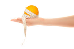 Woman's hand holding orange Stock Image