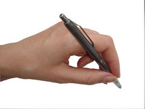 Woman's hand holding a pen Stock Image
