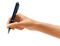 Woman's hand holding a pen Stock Photo
