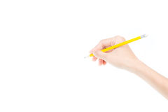 Woman's hand holding a pencil Stock Image