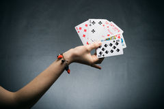Woman's hand holding playing cards Royalty Free Stock Image