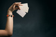 Woman's hand holding playing cards Stock Photos