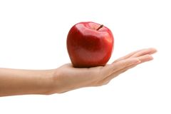 Woman's hand holding red apple. Woman's hand holding red sweet apple Royalty Free Stock Photos