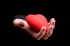Woman's hand holding a red heart Royalty Free Stock Image