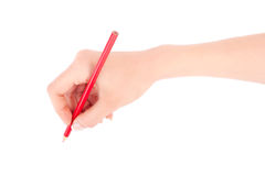 Woman's hand holding a red pencil Stock Photo