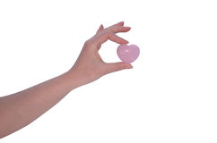 Woman's hand holding Rose Quartz heart Stock Photo