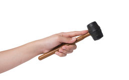 Woman's hand holding a rubber mallet on white background Royalty Free Stock Photography