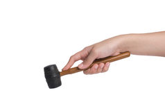 Woman's hand holding a rubber mallet on white background Royalty Free Stock Photo