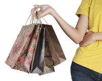 Woman's hand holding shopping bag. Closeup of a woman's hand holding shopping bag Royalty Free Stock Photos
