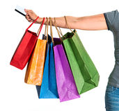 Woman's hand holding shopping bags Stock Photos