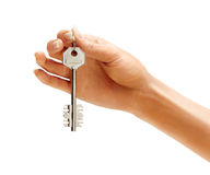 Woman's hand holding silver key Stock Photos
