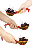 Woman's hand holding a spoon with berries. Woman's hand holding a large wooden spoon with cherry berries Royalty Free Stock Photos