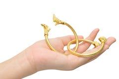 Woman's hand holding Thai gold bracelet design Stock Image