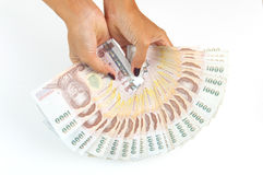 Woman's hand holding Thailand 1000 Baht banknotes royalty free stock photography
