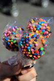 Woman's hand holding three cake pops Royalty Free Stock Images