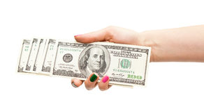 Woman's hand holding 100 US dollar banknotes Stock Image