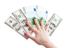 Woman's hand holding 100 US dollar and euro banknotes Royalty Free Stock Photo